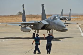 Louisiana Air National Guardsman Senior Airman Joshua Matherne, F-15 crew chief for the 159th Fighter Wing, marshals an F-15 returning from a training mission during Juniper Stallion 2013, Aug. 30, 2013, Nevatim Air Base, Israel. Juniper Stallion 2013 is a combined, bilateral F-15/F-16 air-to-air exercise designed to improve the interoperability and cooperation between the U.S. and Israeli Air Forces in southern Israel.